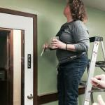 OSPS Assistant Director, Julie Starrett, painting at the new retail space for Bath Works by Bobbi.